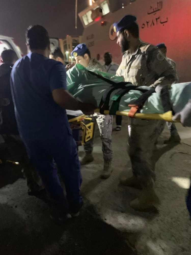 The rescue team carries the French woman from the Border Guard vessel Al-Layth to an ambulance at Prince Mohammed Bin Naif air base in Jeddah.