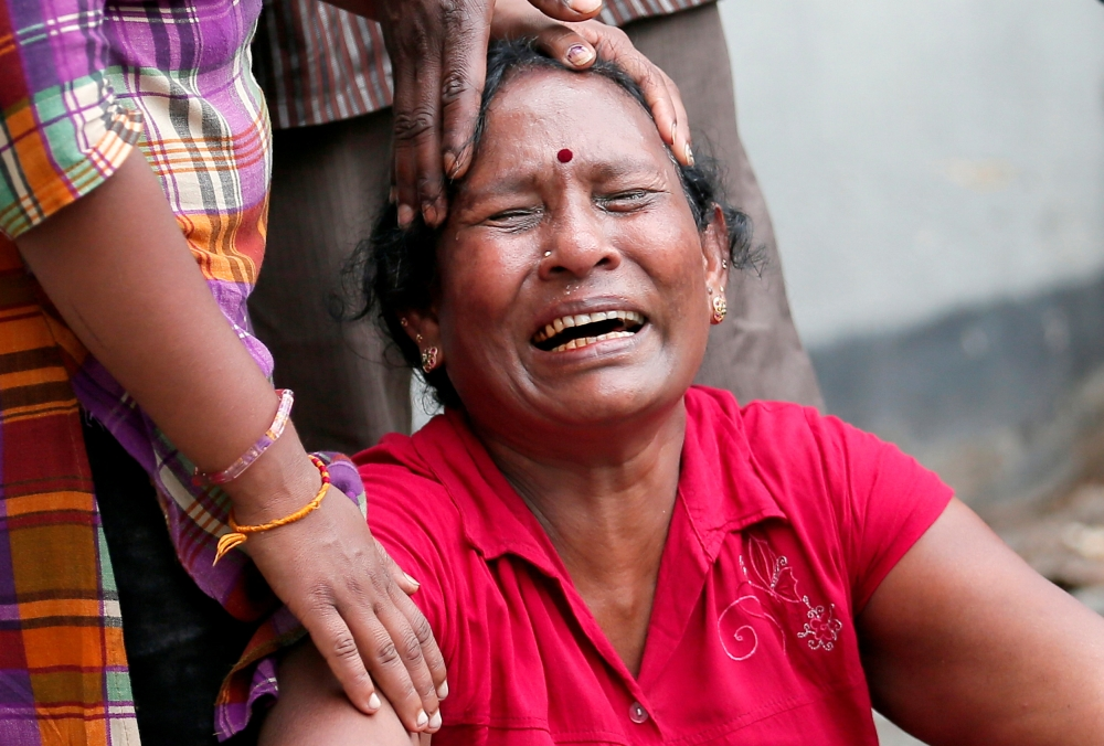 A relative of a victim of the explosion at St. Anthony's Shrine, Kochchikade church, reacts at the police mortuary in Colombo. — Reuters