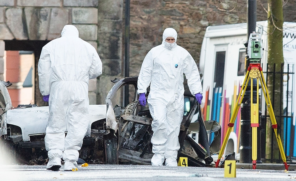 Police forensic officers work at the scene in the aftermath of a suspected car bomb explosion in Derry, Northern Ireland, in this Jan. 20, 2019. — AFP