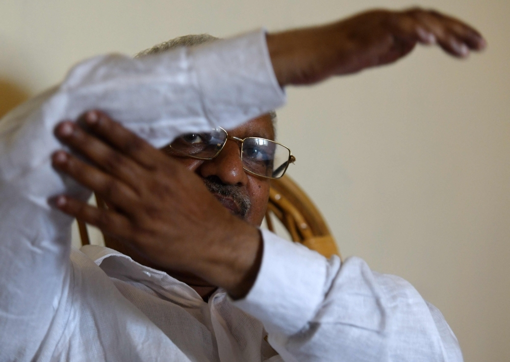 P. Jayarajan, a Communist Party of India (Marxist) electoral candidate and who was a target of political violence in 1999, gestures during an interview at Vadakara in the southern Indian state of Kerala in this April 19, 2019 file photo. — AFP