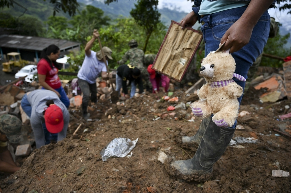 Rescue workers and locals search for victims after a landslide in Rosas, Valle del Cauca department, in southwestern Colombia, on Monday. — AFP