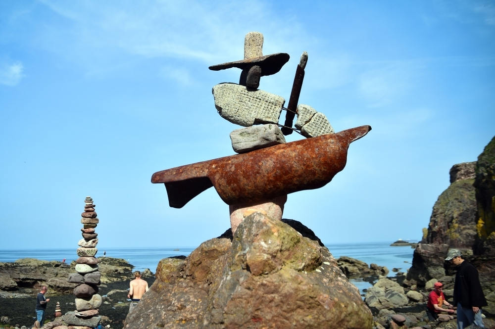 Pictures show a balanced sculpture built during the European Stone Stacking Championships 2019 in Dunbar, Scotland. — AFP
