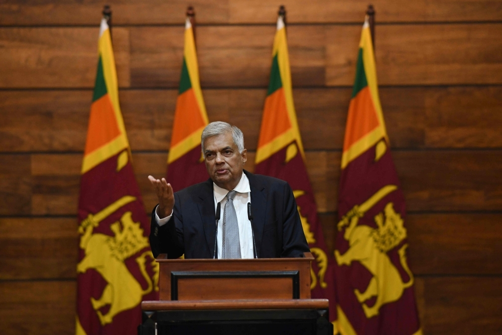 Prime Minister of Sri Lanka Ranil Wickremesinghe gestures as he answers questions from a journalist during a press conference in Colombo on Tuesday. — AFP