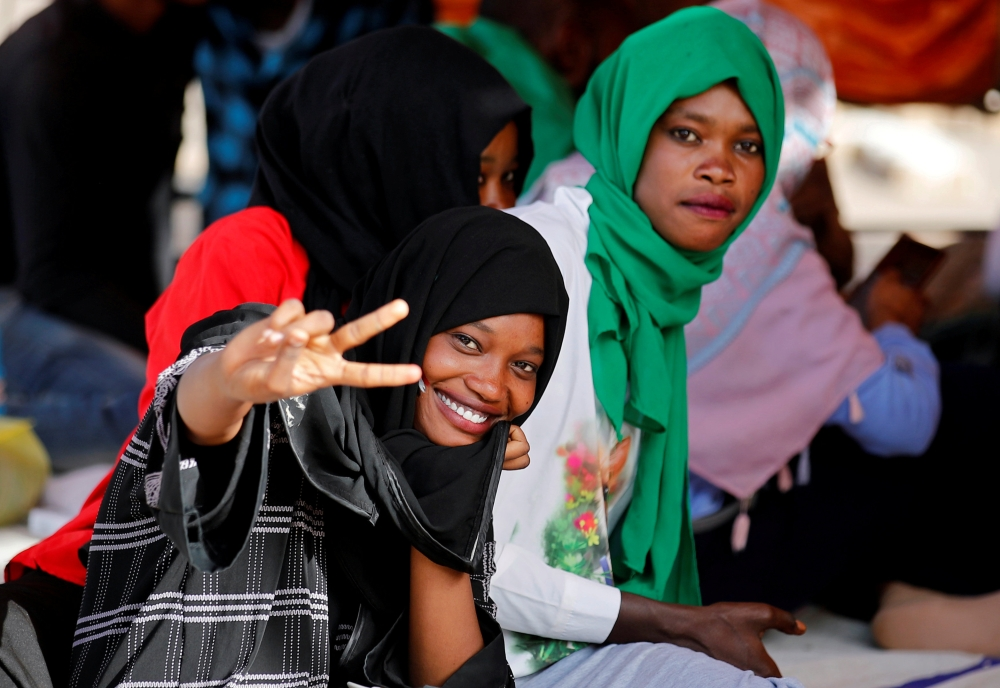 A protester makes a victory sign during a demonstration in front of the Defense Ministry in Khartoum. — Reuters