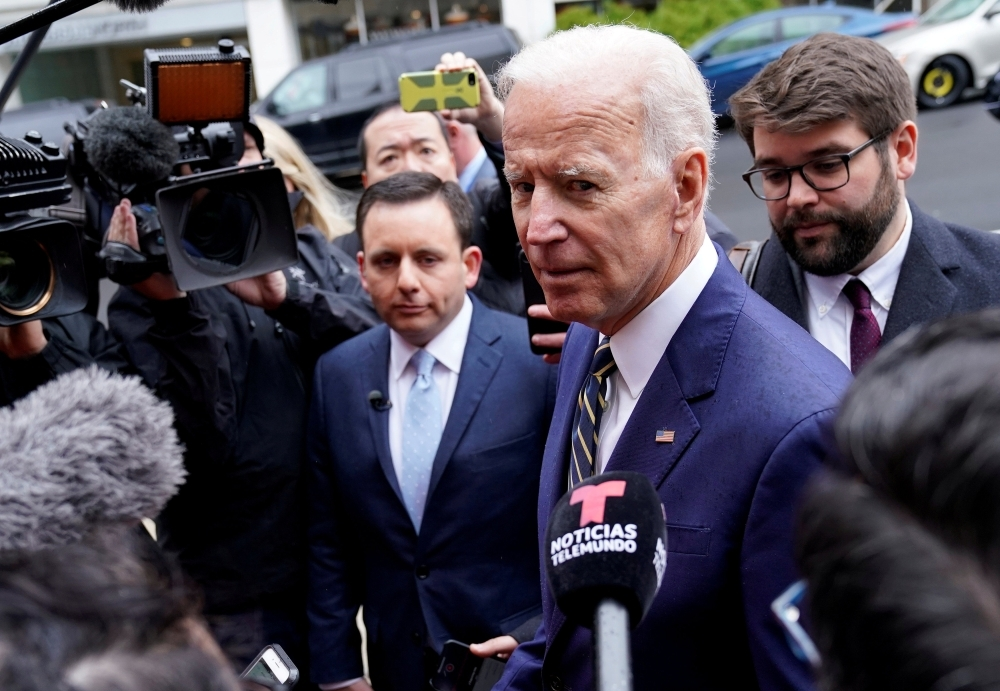Former US Vice President Joe Biden, who is mulling a 2020 presidential candidacy, speaks to the media after speaking at the International Brotherhood of Electrical Workers' (IBEW) construction and maintenance conference in Washington in this April 5, 2019 file photo. — Reuters