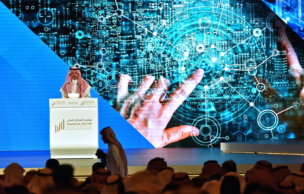 Saudi Finance Minister Mohammed Al-Jadaan addresses the Financial Sector Conference in Riyadh on Wednesday.  The event is organized by the government bodies overseening the implementation of the Financial Sector Development Program, which are the Ministry of Finance, the Saudi Arabian Monetary Authority (SAMA) and the Capital Market Authority (CMA). — AFP