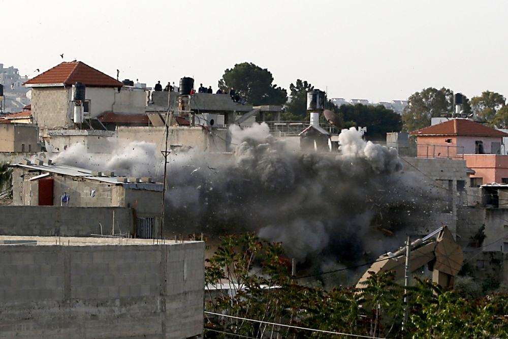 TOPSHOT - Israeli forces blow up the family house of Palestinian assailant Omar Abu Laila, in Az-Zawiya village, in the Israeli-occupied West Bank, on Wednesday. — AFP