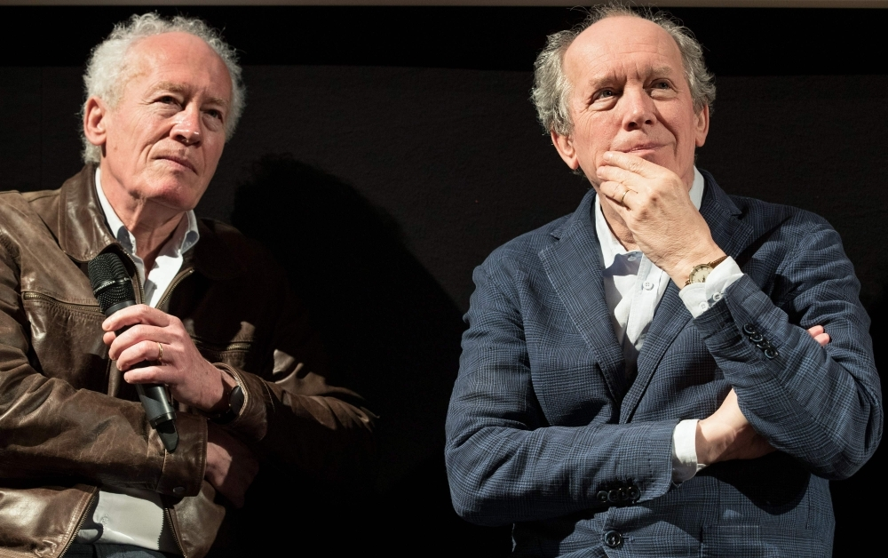 Belgium film directors Jean-Pierre (L) and Luc Dardenne speak during a conference on the Belgium film industry presented during the upcoming Cannes Film Festival, in Brussels. — AFP