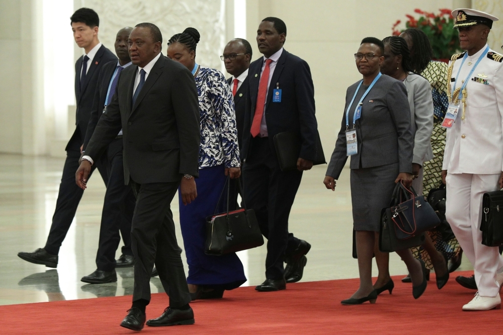 Kenya's President Uhuru Kenyatta (L) arrives for a meeting with Chinese President Xi Jinping (not in picture) at the Great Hall of People in Beijing on Thursday. — AFP