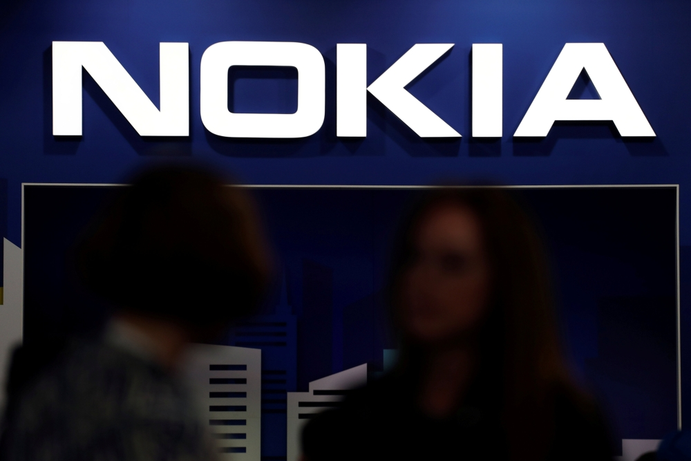 FIle photo shows visitors gathering outside the Nokia booth at the Mobile World Congress in Barcelona, Spain, in February. — Reuters