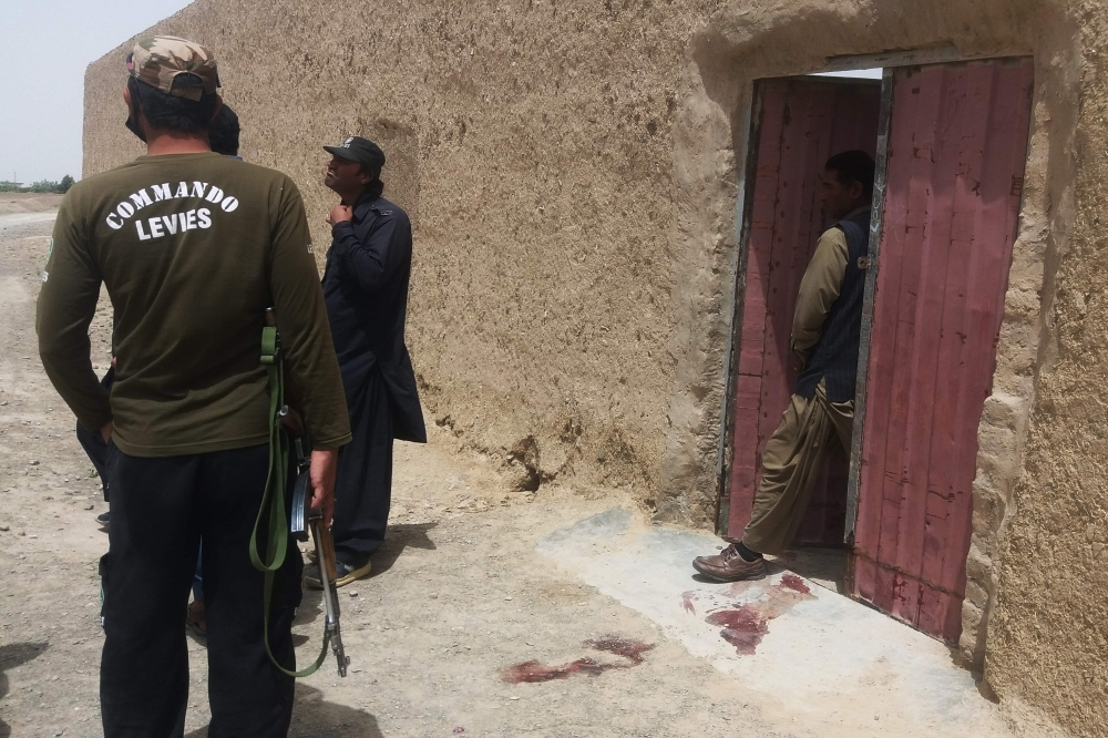 Pakistani security officials gather at the site of an attack by gunmen on a polio vaccination team in the town of Chaman in Balochistan province on Thursday. — AFP