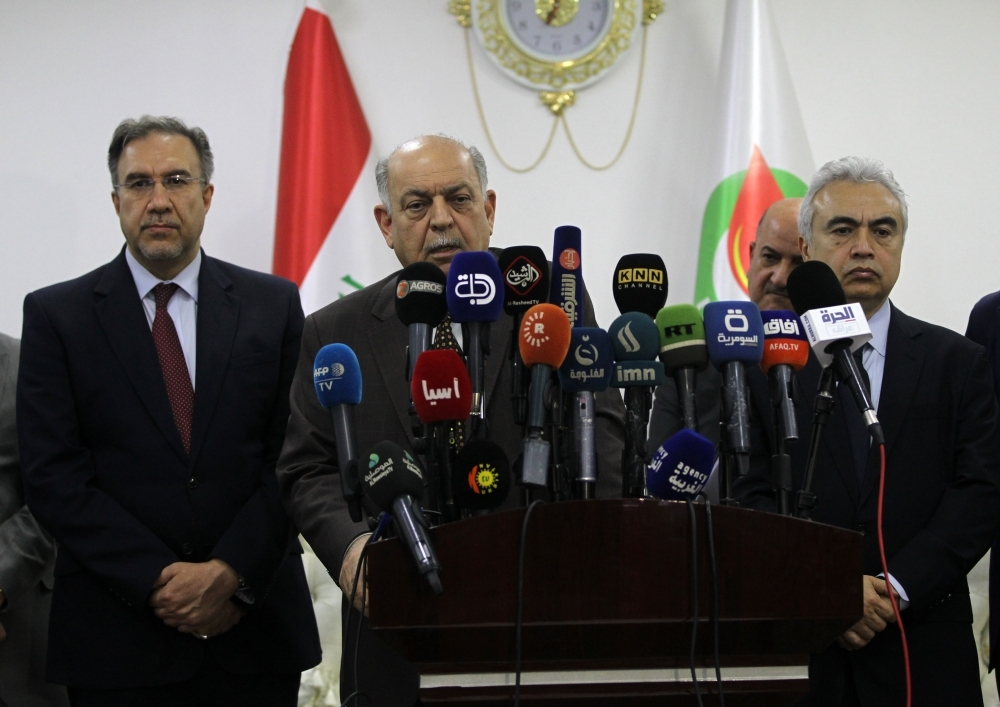 (L to R) Iraq's Electricity Minister Luay Khatib, Oil Minister Thamer Al-Ghadhban, and the Executive Director of the International Energy Agency Fatih Birol give a press conference at the Iraqi Oil Ministry's headquarters in the capital Baghdad on Thursday. — AFP