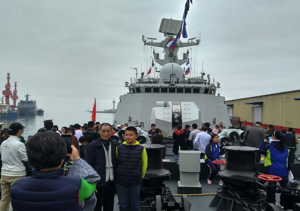 People visit China's guided-missile frigate Rizhao during a public open day in Qingdao in China's eastern Shandong province on Wednesday. — AFP