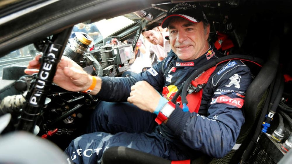 Carlos Sainz of Spain celebrates after winning Dakar rally in this file photo. Sainz said he looked forward to tackling the dunes and deserts of Saudi Arabia next year as Dakar Rally organizers presented the 'third chapter' of their endurance event on Thursday. _ Reuters