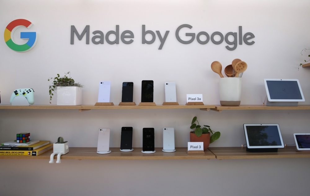 The new Google Pixel 3a (top shelf) is displayed during the 2019 Google I/O conference at Shoreline Amphitheatre on Tuesday in Mountain View, California. Google CEO Sundar Pichai delivered the opening keynote to kick off the annual Google I/O Conference that runs through Wednesday. — AFP