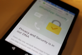 A security message is seen on a Whatsapp screen in this illustration photo April 6, 2016.  — Reuters