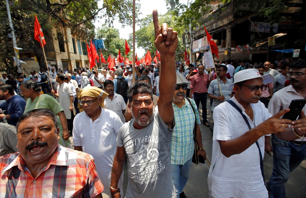 Supporters of the Communist Party of India-Marxist (CPI-M) shout slogans during a protest march after a statue of Ishwar Chandra Vidyasagar, an academic, was damaged during Tuesday's clashes between supporters of India's ruling Bharatiya Janata Party (BJP) and the Trinamool Congress, a major regional party, in Kolkata. — Reuters