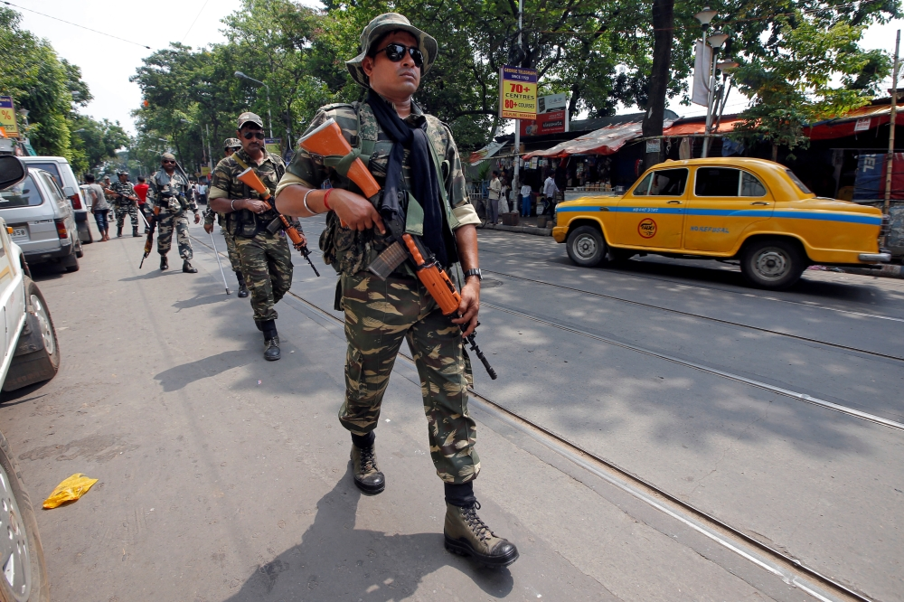 Central Reserve Police Force (CRPF) personnel conduct route march in a street ahead of the seventh and last phase of general election, in Kolkata, India, Wednesday. — Reuters
