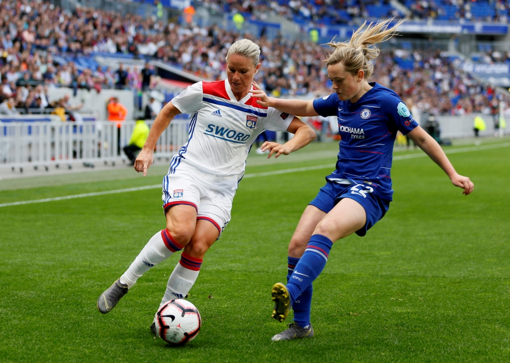 Olympique Lyonnais' Amandine Henry in action with Chelsea's Erin Cuthbert during the recent Women's Champions League semifinal first leg at the Groupama Stadium, Lyon, France. — Reuters