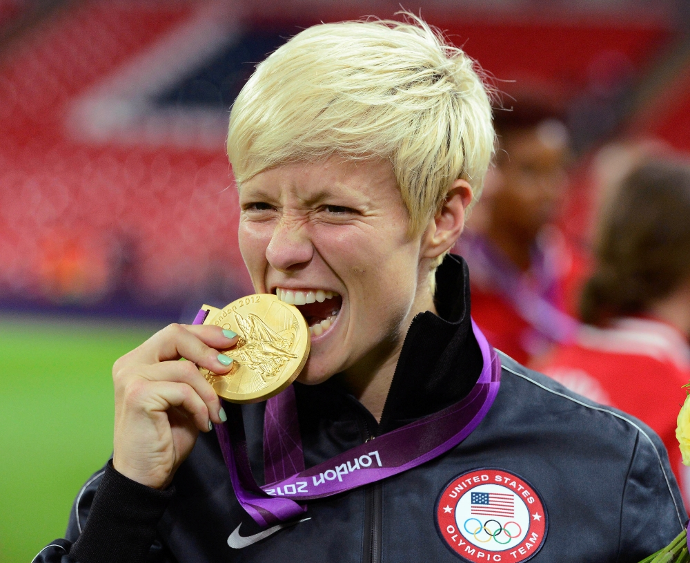 File photo shows Megan Rapinoe of the US celebrating after defeating Japan in the women's final soccer match at the London 2012 Olympic Games in London at Wembley Stadium. — Reuters