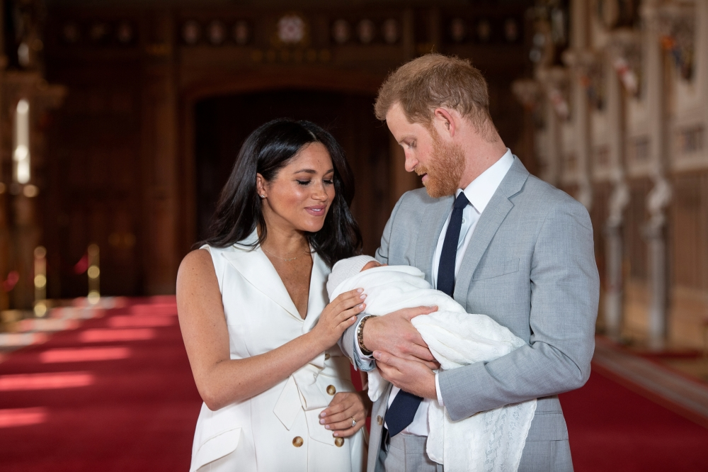 Britain's Prince Harry and Meghan, Duchess of Sussex are seen with their baby son, who was born on Monday morning, during a photo-call in St George's Hall at Windsor Castle, in Berkshire, Britain, in this May 8, 2019 file photo. — Reuters