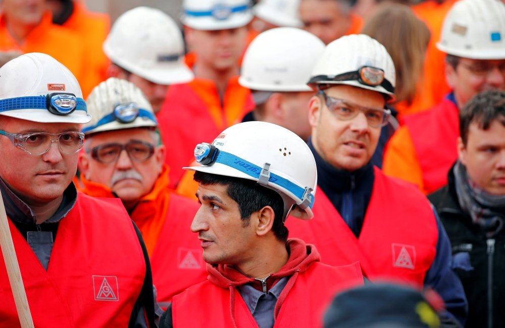 Workers of German steel maker ThyssenKrupp AG protest in a warning strike organized by German union IG Metall for higher wages at the ThyssenKrupp steel Europe plant of Dortmund, Germany, in this file photo. — Reuters