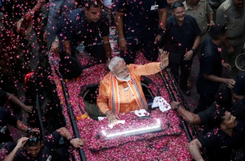 India's Prime Minister Narendra Modi waves toward his supporters during a roadshow in Varanasi, India, in this April 25, 2019 file photo. — Reuters