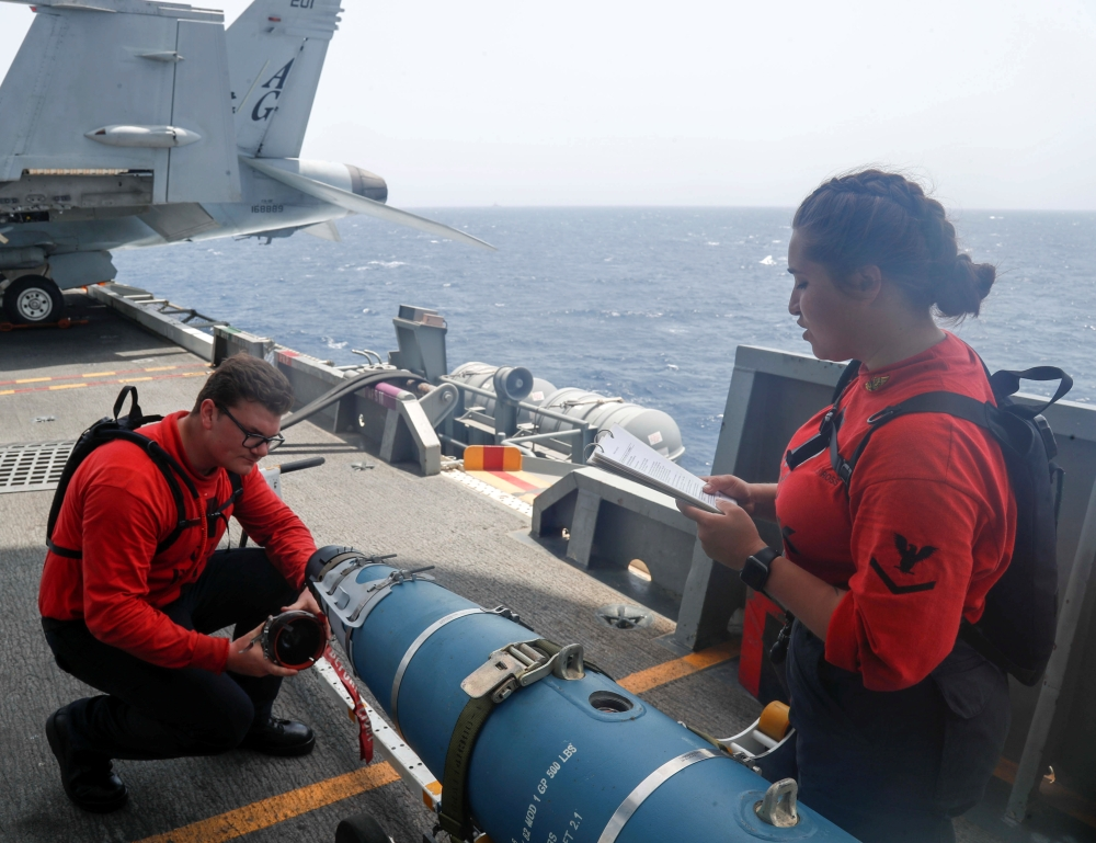 US Sailors, review ordnance bomb checks on the flight deck of aircraft carrier USS Abraham Lincoln (CVN 72), in Arabian Sea. — Reuters