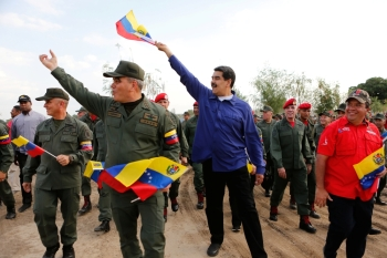 Venezuela's President Nicolas Maduro gestures next to Venezuela's Defense Minister Vladimir Padrino Lopez, during a ceremony at a military base in Maracay, Venezuela May 17. - Reuters