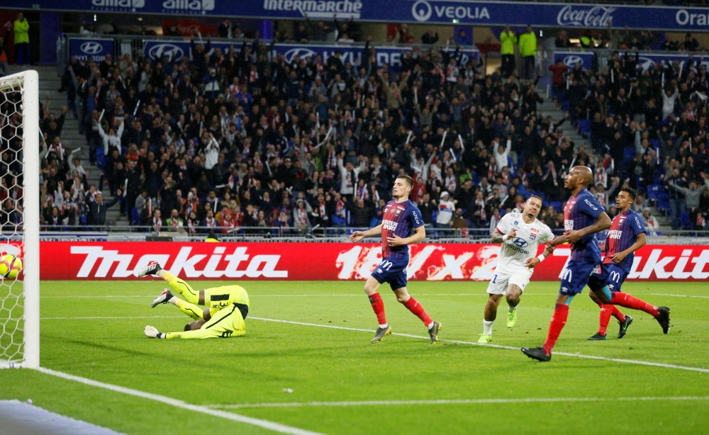Lyon's Memphis Depay celebrates scoring their fourth goal in Lyon, France, on Saturday. — Reuters