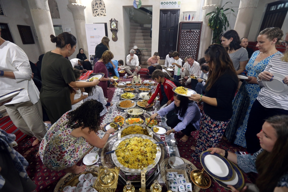 Foreign visitors and residents in the UAE eat an Emirati Iftar meal at Sheikh Mohammed Centre for Cultural Understanding (SMCCU) in Dubai in this May 17, 2019 file photo. — Reuters