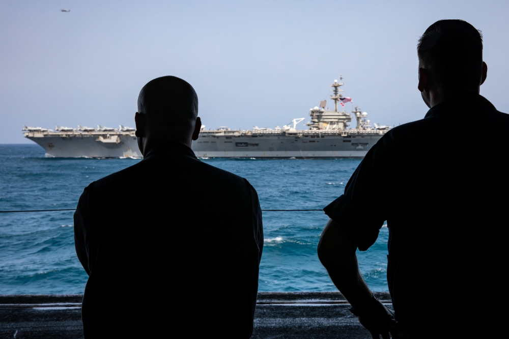 US sailors watch the aircraft carrier USS Abraham Lincoln in Arabian Sea in this May 17, 2019 file photo. — Reuters