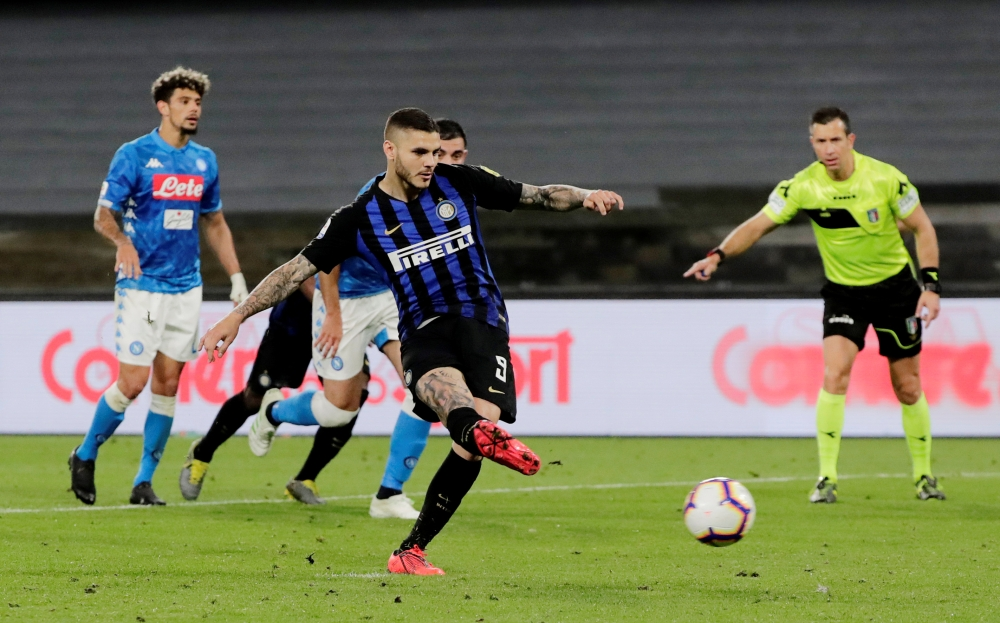 Inter Milan's Mauro Icardi scores their first goal from the penalty spot in Naples, Italy, on Sunday. — Reuters