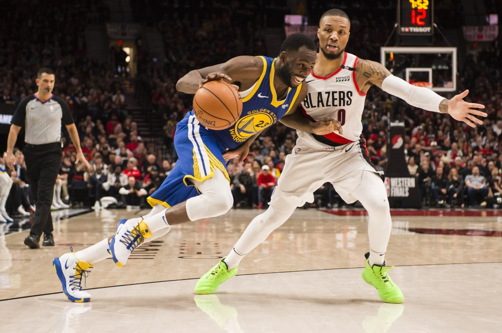 Golden State Warriors forward Draymond Green (23) drives to the basket against Portland Trail Blazers guard Damian Lillard (0) during the second half in game three of the Western conference finals of the 2019 NBA Playoffs at Moda Center on Saturday. — Reuters