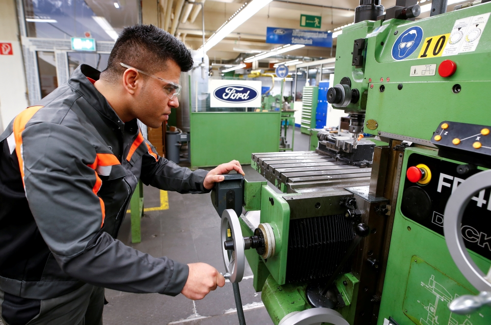 Qudratullah Hotak, a 25-year-old refugee from Afghanistan and one of 24 trainees of Ford Germany's so-called Equipment Qualification (EQ) program to integrate migrants in a booming labor market, adjusts a machine at the training workshop of Ford Motor Co in Cologne, Germany, in this Jan. 11, 2019 file photo. — Reuters