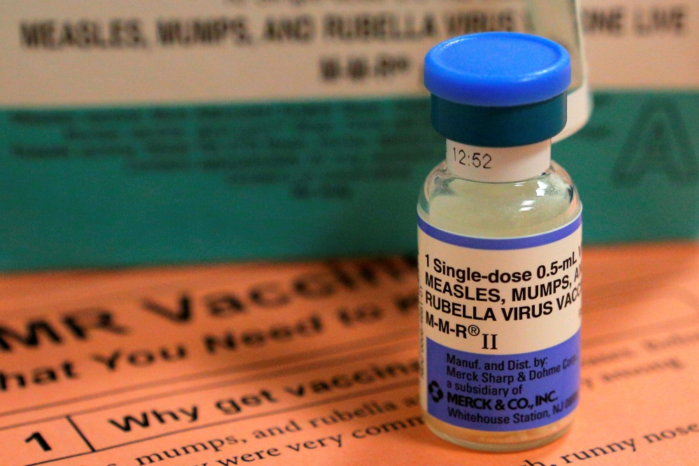 A vial of measles, mumps and rubella vaccine and an information sheet is seen at Boston Children's Hospital in Boston, Massachusetts, in this Feb. 26, 2015 file photo. — Reuters