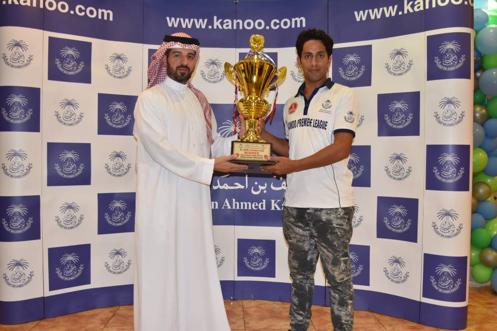 Ahmed Kanoo presenting Kanoo Premier Winner Cup to Atta Muskan Capt of Al Burj.