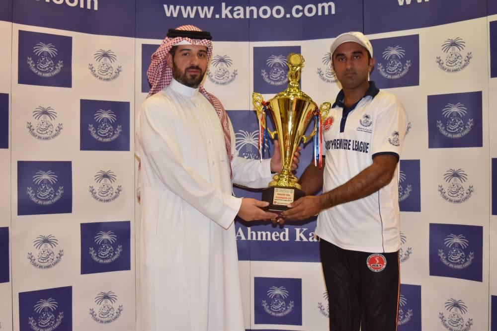 Ahmed Kanoo presenting Kanoo Premier Runner-up Cup to Ateeq Mansha Capt of Saudi Oil.