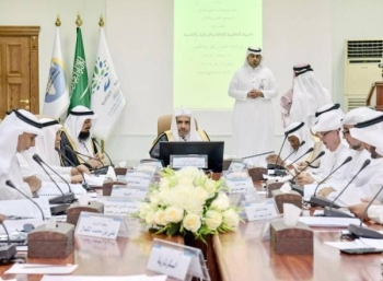 MWL officials discuss distribution of Ramadan food packets among the poor. — Okaz photo