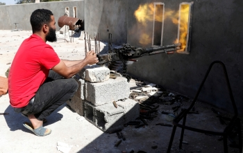 A fighter loyal to Libyan internationally recognized government fires a heavy machine gun during clashes with forces loyal to Khalifa Haftar at outskirts of Tripoli, Libya, in this May 16, 2019 file photo. — Reuters