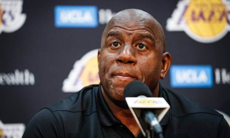 Former Los Angeles Lakers team president Magic Johnson, seen in this file photo, said Monday it was general manager Rob Pelinka's backstabbing ways that led to his resignation in April.