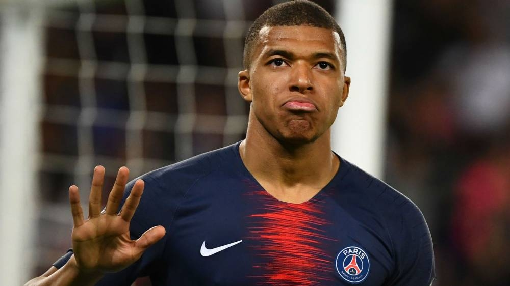 Paris St Germain's Kylian Mbappe, who has already scored 32 goals this season, was named both the best player and best Under-21 player for the 2018-19 season by his peers on Sunday.