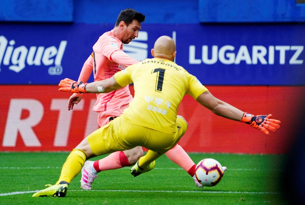 Barcelona's Lionel Messi scores their first goal  against Eibar in the La Liga match at  Ipurua, Eibar, Spain, on Sunday. — Reuters