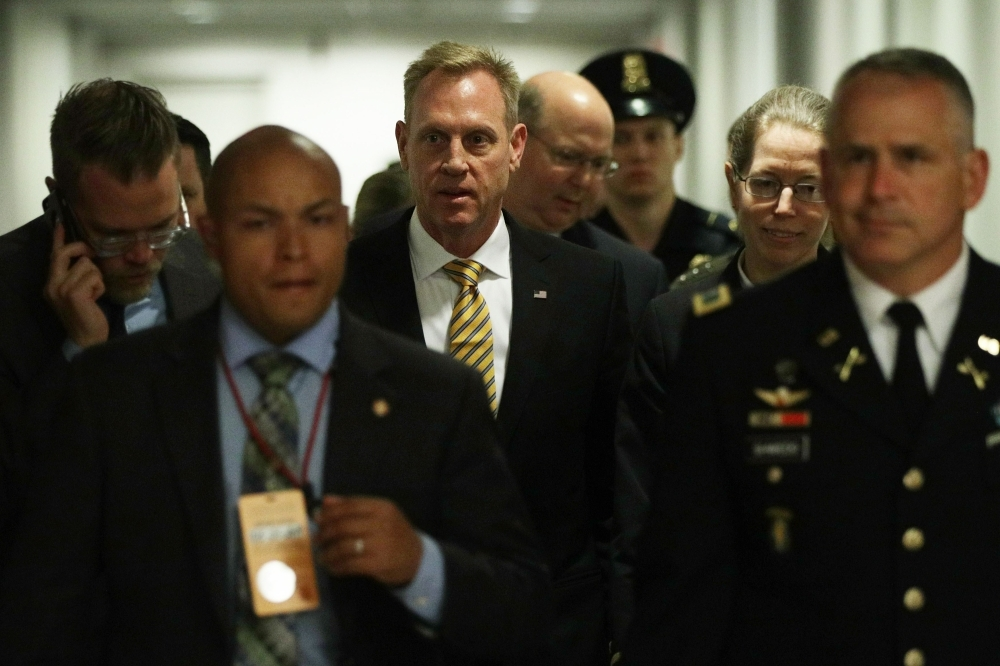 Acting US Defense Secretary Patrick Shanahan (C) arrives at a closed briefing for Senate members Tuesday on Capitol Hill in Washington, DC. Shanahan joined Secretary of State Mike Pompeo and Chairman of Joint Chiefs of Staff Joseph Dunford to brief Congressional members on Iran. — AFP == FOR NEWSPAPERS, INTERNET, TELCOS & TELEVISION USE ONLY ==