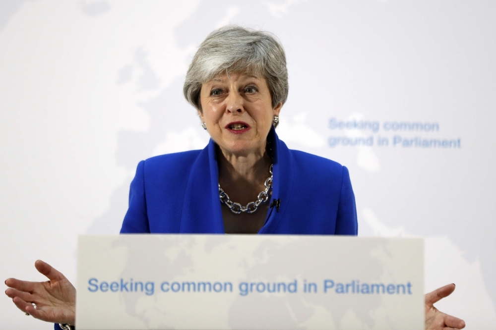 Britain's Prime Minister Theresa May delivers a speech in central London on Tuesday. British Prime Minister Theresa May outlined a series of incentives for MPs to support her Brexit deal, saying there was
