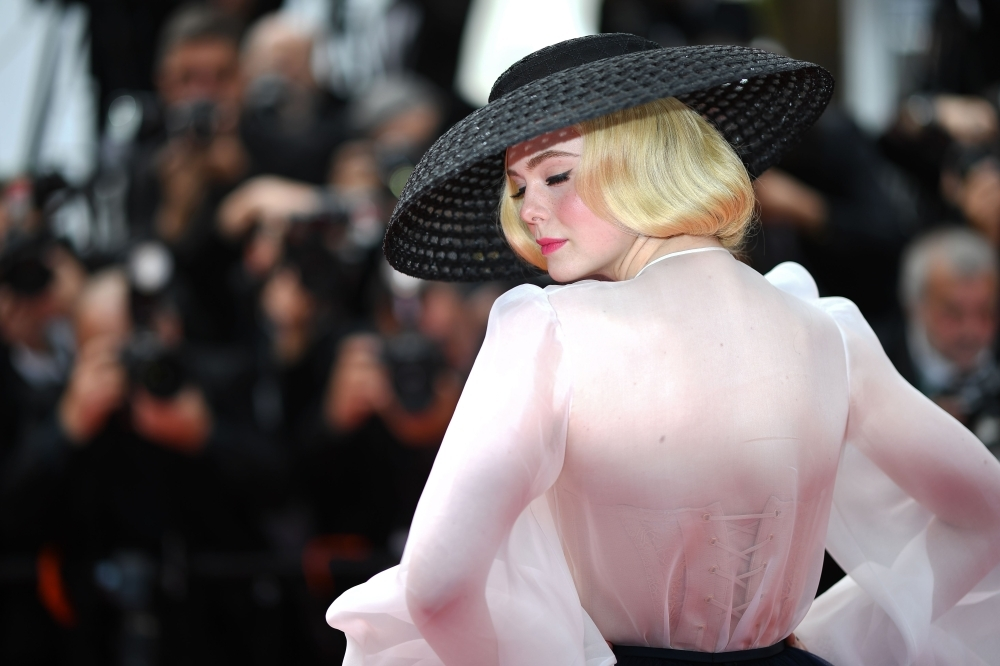 US actress and member of the jury of the Cannes Film Festival Elle Fanning poses as she arrives for the screening of the film