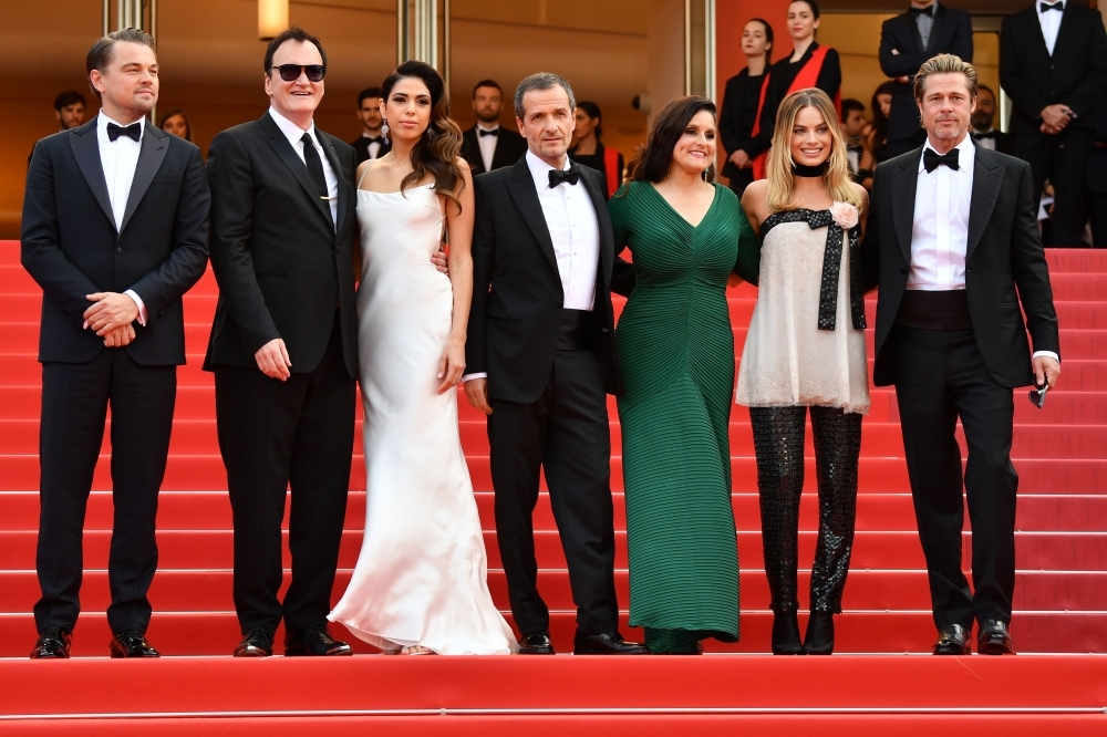 (From L) US actor Leonardo DiCaprio, US film director Quentin Tarantino and his wife singer Daniella Pick, British film producer David Heyman, US producer Shannon McIntosh, Australian actress Margot Robbie and US actor Brad Pitt pose as they arrive for the screening of the film