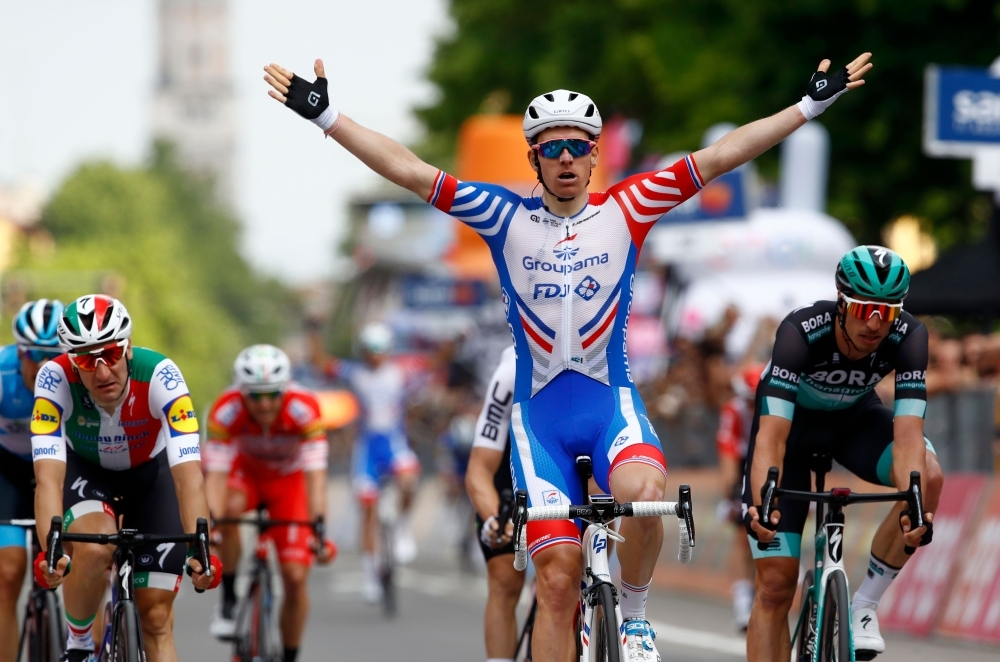 Team Groupama-FDJ rider France's Arnaud Demare celebrates as he finished first in the stage ten of the 102nd Giro d'Italia - Tour of Italy - cycle race, 145kms from Ravenna to Modena on Tuesday. — AFP