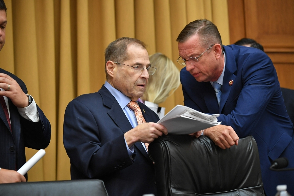 Chairman of the House Judiciary Committee, US Representative Jerry Nadler (L), speaks with Ranking Member, US Representative Doug Collins,during a hearing where former White House lawyer Don McGhan was expected to testify on the Mueller report, on Capitol Hill in Washington, DC, on Tuesday. US President Donald Trump has told McGhan to ignore a subpoena from Congress to testify about the president's alleged obstruction of justice. — AFP