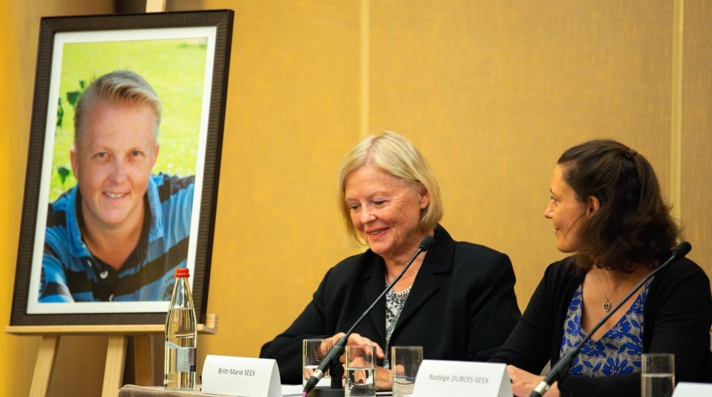 Britt-Marie Seex (C) gestures as she addresses a press conference with Nadege Dubois-Seex (R) in Paris on Tuesday, alongside a portrait of the late Jonathan Seex who was killed in an Ethiopian Airlines Boeing 737 Max 8 aircraft crash on March 10, 2019, on a flight between Addis Ababa and Nairobi. — AFP